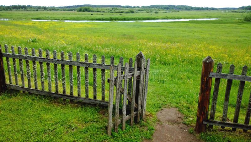 open-gate-wooden-fence-green-meadow